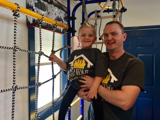 Levi Spencer and his father Jason hang out in his new room.