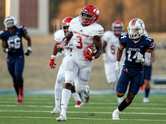 In this Dec. 7, 2019 photo, North Shore Mustangs running back Zachary Evans (3) runs the ball pursued by Atascocita Eagles Jordan Augustine (14) during the second half of a high school football playoff game at Sheldon ISD Panther Stadium in Houston, Texas. The talented running back from Houston quietly signed with Georgia in December, but was later released from his national letter of intent by the Bulldogs. (Tim Warner/Houston Chronicle via AP)