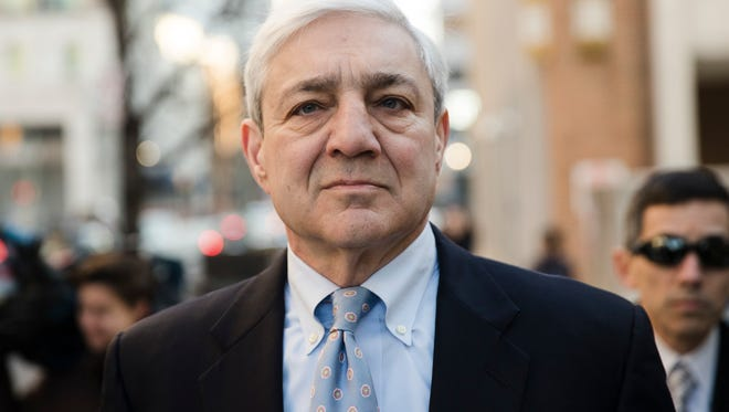 Former Penn State president Graham Spanier walks to the Dauphin County Courthouse in Harrisburg on Monday.