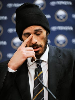 Former Buffalo Sabres goaltender Ryan Miller collects his thoughts during a news conference Friday night in Buffalo.