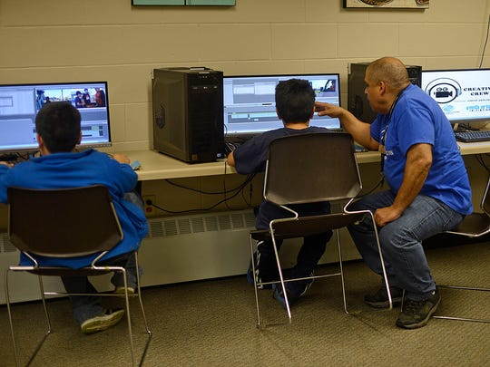 Alex Zacarias, digital video arts director, works with youngsters on their video projects in the Lutsey Clubhouse.