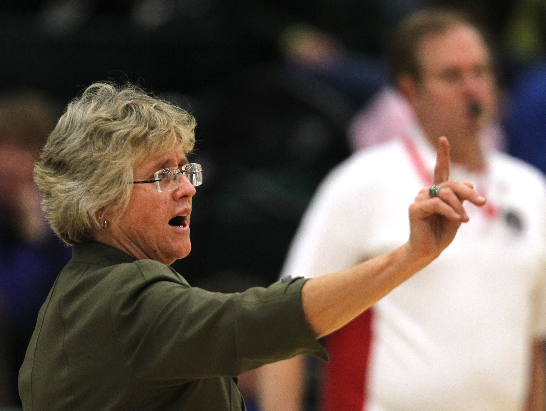 West High head coach Kathy Bresnahan directs her team during the Lady Trojans contest against Dubuque Hempstead on Tuesday evening, October 18, 2011. (Press-Citizen / Benjamin Roberts)