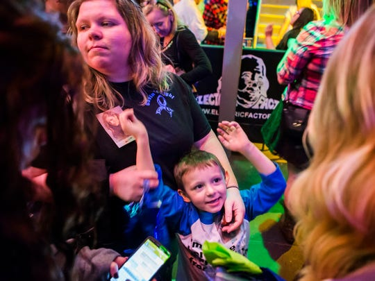 Five year-old Gavin Bender talks with other Cassadee Pope fans before her performance at the Electric Factory in Philadelphia on Friday night, March 12, 2016.