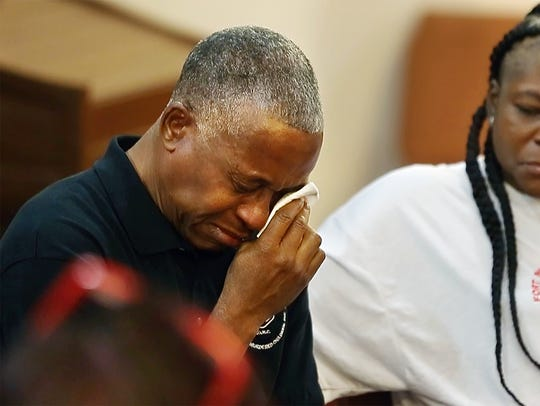 Rev. Ricky L. Anderson weeps as mothers of murdered