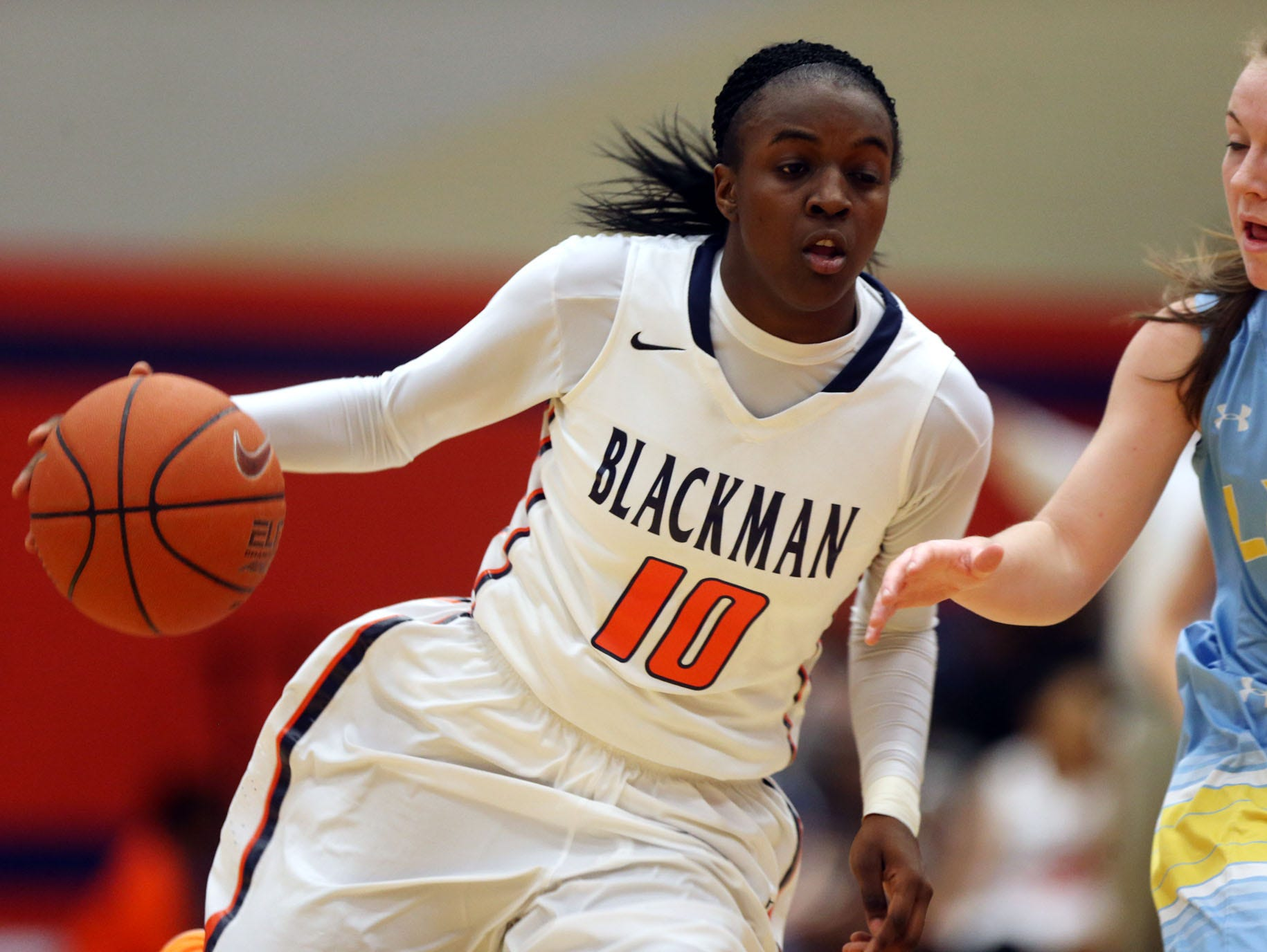 Blackman's Meme Jackson moves against Cumberland County's Madison McLaughlin in the first half Monday, March 2, 2015 at Blackman. Blackman won 75-47.
