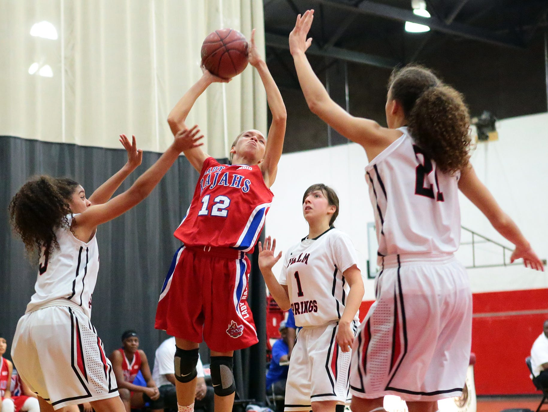 Indio's Jazmyne Santiel (12) puts up a shot over Palm Springs during a Desert Valley League game on Wednesday in Palm Springs. Indio won 57-44 and remains undefeated in league play.