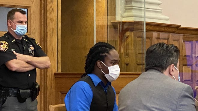 Josiah J. Eutsey, of Canton, sits with his defense attorney, Anthony Koukoutas, on Monday during the first day of Eutsey's murder trial. He's charged in the May 2019 shooting death of 20-year-old Dewayne Jackson Jr.