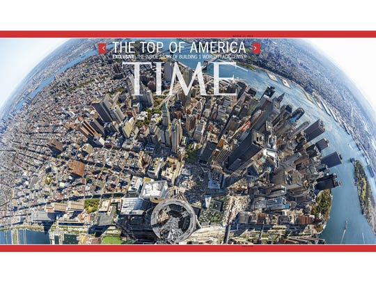 This image provided by Time Inc. shows the cover of the March 17, 2014 issue of Time Magazine, featuring a panoramic photo taken from atop 1 World Trade Center in New York. The image is made up of 567 images taken over the course of five hours and stitched together.  The camera was attached to a 13-foot long aluminum pole and mounted just 10 feet below the tip of the 1,776 tall structure.
