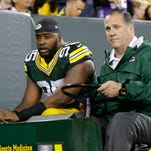 Green Bay Packers defensive end Datone Jones, left, leaves the field after injuring an ankle during the second quarter of the game against the Minnesota Vikings at Lambeau Field on Oct. 2.