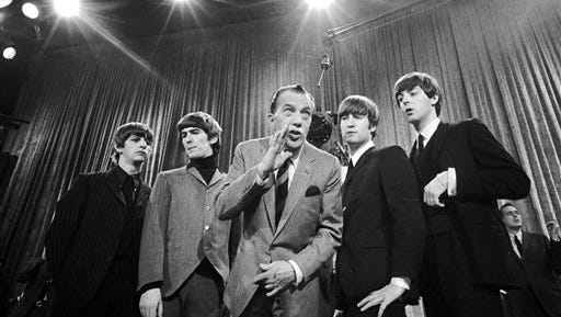 """In this Feb. 8, 1964 file photo, Ed Sullivan, center, stands with The Beatles, from left, Ringo Starr, George Harrison, John Lennon and Paul McCartney, during a rehearsal for the British group's first American appearance on """"The Ed Sullivan Show,"""" in New York. A small, 18-inch solid bronze statue of the legendary television variety show host, Sullivan, has been recovered by Los Angeles police Thursday. The statue was taken Sunday from atop a pedestal in an outdoor exhibit at the Academy of Television Arts & Sciences Hall of Fame Plaza in North Hollywood."""