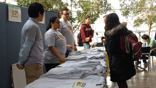 """University of Rochester students talk with volunteers at a tabling event for the university's anti-racism initiative """"We're Better Than That""""  on March 21, 2016."""