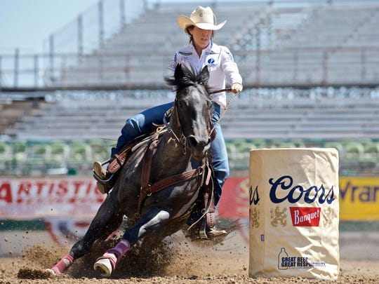 Nellie Miller competes in the barrel-racing event on her horse Sister during a rodeo earlier this year in Reno.