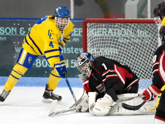 St. Cloud Cathedral's Jake Van Halbeck jams the puck