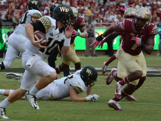 Ermon Lane closes in on Wake Forest's John Wolford.