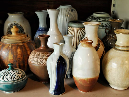Pottery pieces created by Jim Loso that are in storage Sunday.