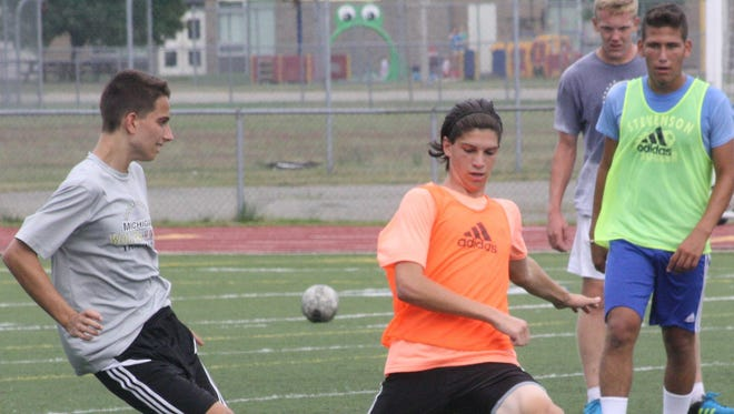 Pictured (from left) are Livonia Stevenson soccer players Justin Schultz, Andrew Vrzovski and Sandro Lytwyn.
