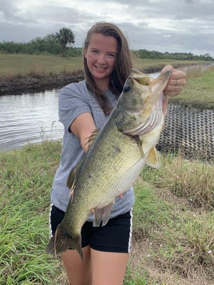Emily Hanzlik caught this 7 pound, 4 ounce largemouth bass using a Senko while working one of the canals in the Loxahatchee area.