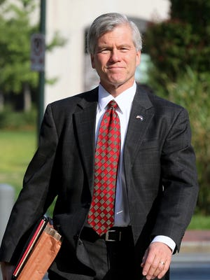 Former Virginia Gov. Bob McDonnell heads into the federal courthouse in Richmond, Va., Wednesday, Aug. 6, 2014, as the federal corruption trial against him and former first lady Maureen McDonnell continues. The McDonnells are charged with accepting more than $165,000 in gifts and loans from Jonnie Williams, the former CEO of dietary supplements maker Star Scientific Inc., in exchange for helping promote his company's products. (AP Photo/Richmond Times-Dispatch, Bob Brown)