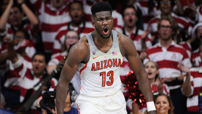 Arizona Wildcats forward Deandre Ayton (13) celebrates after scoring against the UMBC Retrievers during the first half at McKale Center.