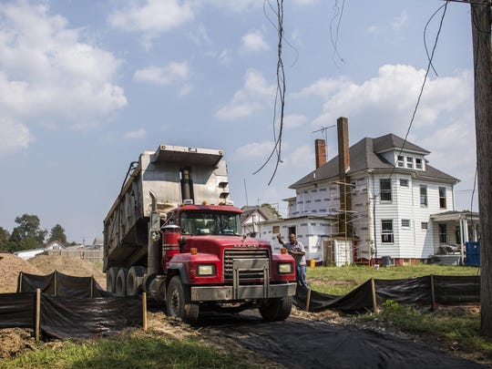 Workers lay a gravel base for an entry drive to the future town hall in Townsend on Thursday afternoon.