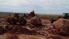 Heavy equipment was used to clear the highway of mud and large boulders.