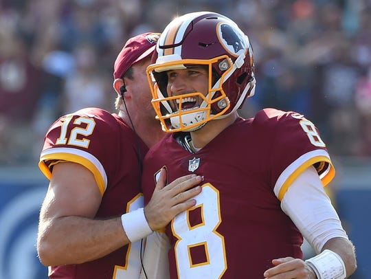 Washington Redskins quarterback Kirk Cousins (8) celebrates