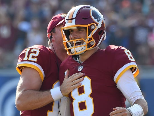 Washington Redskins quarterback Kirk Cousins (8) celebrates with Washington Redskins quarterback Colt McCoy (12) after throwing what turned out to be the game winning touchdown in the game against the Los Angeles Rams at the Los Angeles Memorial Coliseum.