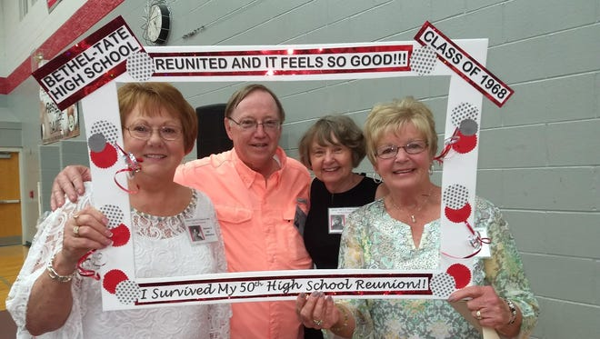 From left, Dolly Ast McKeehan, Robert Blankenship, Jackie Chapman Borgia, and Debbie Blackburn Toft get framed for being members of the Class of 1968, the 50-year honor class at the 119th annual Bethel-Tate alumni dinner.