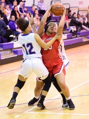 Port Clinton's Delayna Laurel and Braelyn Horn of Fremont Ross fight for possession Monday.