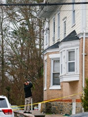 Newark police investigate after a 20-year-old man fell from the roof of a home on W. Main Street during a party in 2016.