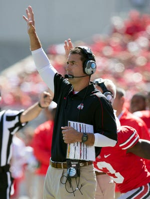 Ohio State Buckeyes co-defensive coordinator Luke Fickell calls in the defensive set against the UAB Blazers at Ohio Stadium.