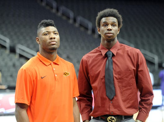 USA TODAY Sports projects the 2013-14 All-America first and second teams. (Pictured: Oklahoma State's Marcus Smart and Kansas' Andrew Wiggins)