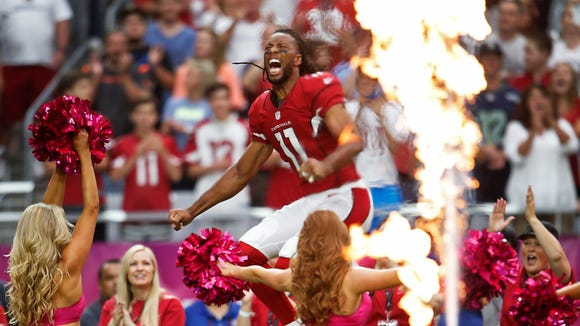 Cardinals WR Larry Fitzgerald is introduced before playing against the Redskins in NFL action at University of Phoenix Stadium in Glendale, Ariz. October 12, 2014.