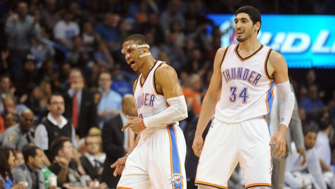 Russell Westbrook, left, and Enes Kanter react after a play during the fourth quarter at Chesapeake Energy Arena.