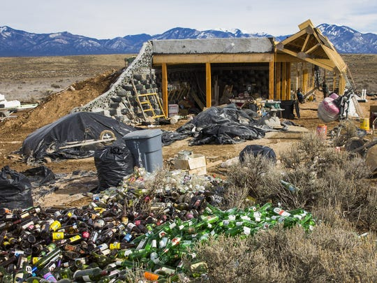 Bottles pile up at a new home under construction at