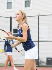 Monmouth University's Farrah Smoke juggles tennis,