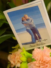 A photograph of Jenilyn Addis Franklin and Brandon Franklin on the day of their engagement in Cape May, New Jersey, is one of the treasured keepsakes that Darleen Addis has of her daughter. (Clay Owen / News Sentinel).