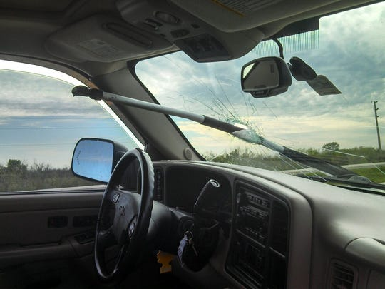 An oar smashed through the windshield of a driver on Alligator Alley Friday. The driver was unhurt.