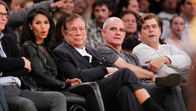 Los Angeles Clippers owner Donald Sterling and V. Stiviano in 2010.
