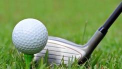 A golf ball and putter