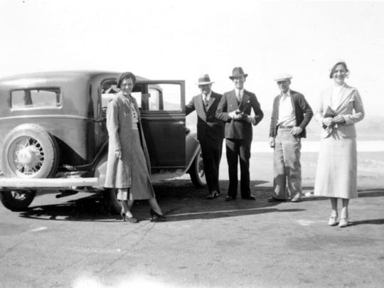 Roy Frisch, with his hand on the door of the automobile, is shown with unidentified men and women in this undated file photo. The former Reno city councilman disappeared in 1934 before testifying in the federal trial of two Reno men suspected of fraud; he was never found.