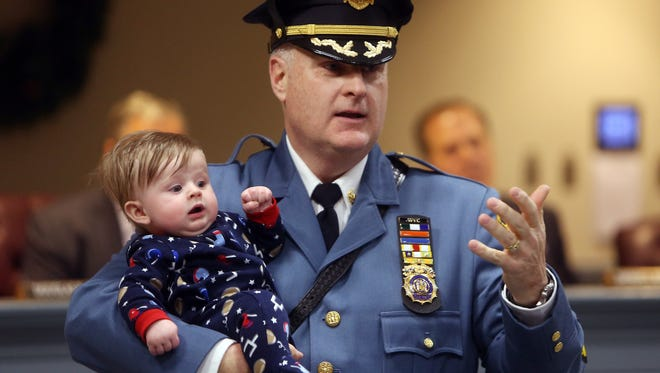 New Morris County Sheriff James Gannon speaks while holding his 4-month-old grandson Luca after he was sworn in by Lt. Gov. Kim Guadagno at the Morris County Administration and Records building in Morristown. January 6, 2017, Morristown, NJ.