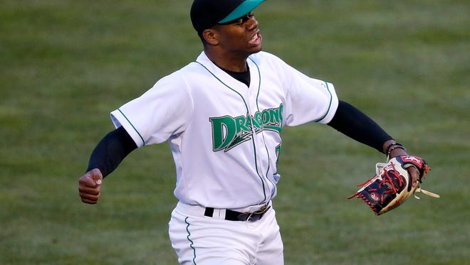 Dayton Dragons pitcher Hunter Greene (3) cheers as he collects his eighth strikeout of the game during the third inning of the MiLB game between the Dayton Dragons and the Lake County Captains at Fifth Third Field in Dayton, Ohio, on Monday, April 9, 2018. Greene, the Cincinnati Reds first-round draft pick, finished his three-inning Dragons debut with eight strikeouts on 50 pitches.