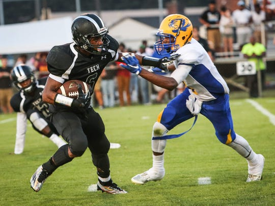 Receiver-safety Jamir Dantley (right), shown against Sussex Tech last season, is a two-way returning starter for A.I. du Pont.