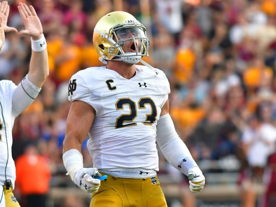 Sep 16, 2017; Chestnut Hill, MA, USA; Notre Dame Fighting Irish linebacker Drue Tranquill (23) celebrates in the third quarter against the Boston College Eagles at Alumni Stadium.