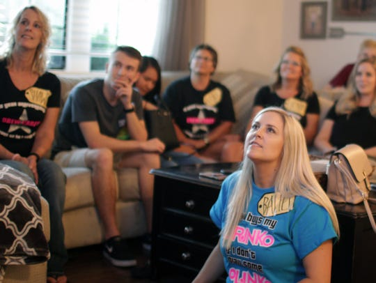 Bailey O'Callaghan, right, watches an episode of the