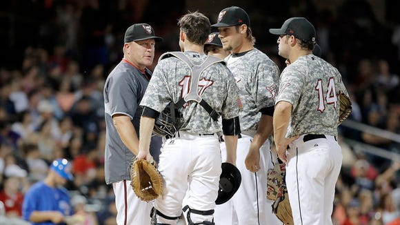 Chihuahuas Manager Pat Murphy looks for answers on the hill during their game against Iowa.