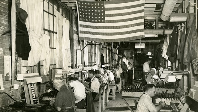 Taken around 1943, this image shows Ithaca Gun Company employees at work during World War II, when the Gun Company produced approximately half of the .45 caliber pistols for the US Army.