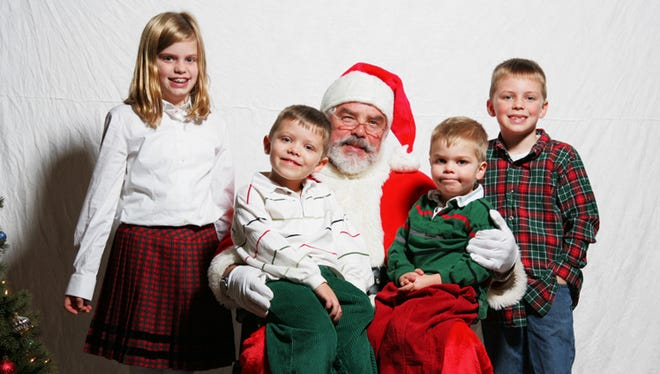 Kate, Christian, Luke and Will Robinson with Santa.