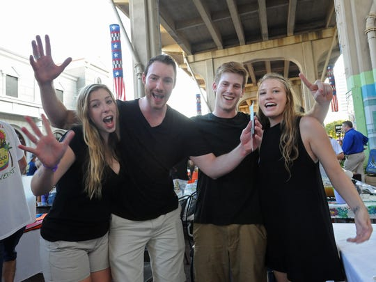 Superior's Steakhouse employees Jane Marie Stringfellow (left), Garrett Denmon, Connor Wilson and Kelsey Broadway celebrate after winning the 2nd annual Red River Margarita Pour Off held in Shreveport's Red River District.